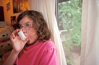 Eleven-year-old Mariel West uses an inhaler for her asthma, Detroit, Michigan, USA