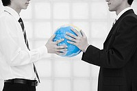 Office workers holding globe