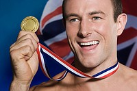 Sportsman holding a gold medal