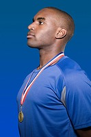 African american athlete with a gold medal