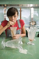 Girl drinking a milkshake
