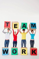 People holding boxes that read team work