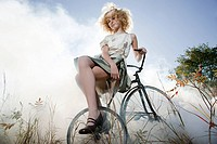 Girl sitting on bicycle