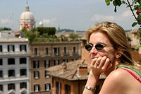 Woman looking over view of Rome