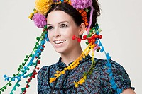Young woman wearing pom pom headdress (thumbnail)