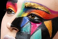 Woman with colourful pattern on face