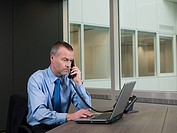 Businessman on telephone with laptop