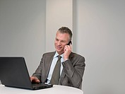 Businessman on cellphone with laptop