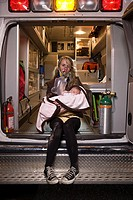 Young woman and baby in ambulance (thumbnail)