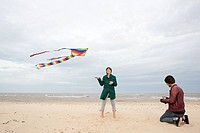 Couple on a beach with kite