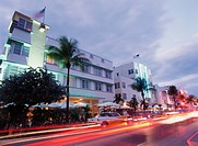 Cars driving in front of buildings in South Beach, blurred motion