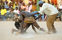 wrestling match at AbÚnÚ festival, fighters with referee, Senegal, Casamance, AbÚnÚ, Dez 04.