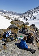 Group of alpinists, relaxing and enjoying the summit panorma, Chilkoot Pass/Trail, Klondike Gold Rush, British Columbia, B.C., Canada, North America