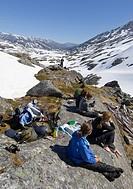Group of alpinists, relaxing and enjoying the summit panorma, Chilkoot Pass/Trail, Klondike Gold Rush, British Columbia, B.C., Canada, North America