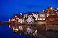 Houses and their reflection in the river in the historic town of Whitby