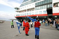 The Passengers get off the Trollfjord in the harbour of Vardö by the Arctic Ocean in the Varanger Peninsula, Norway. The passenger ship sails along th...