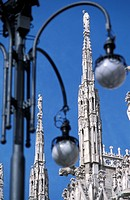 Street light with Duomo Cathedral in background