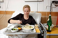Patient having lunch in a hospital bed