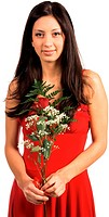 Beautiful latina woman in a red Valentine´s Day dress with a red rose fern and baby´s breath