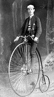 Historic photograph, man riding a penny-farthing