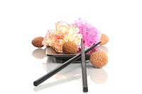 Carnation blossoms with lychees and chopsticks