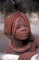 Himba, girl with typical headdress and decoration trappings on the neck, Namibia, Kunene, Kaokoland