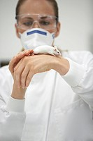 Scientist holding mouse on hand