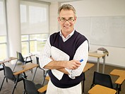 Smiling professor in classroom