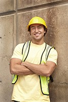 Construction worker in reflective vest and hard_hat smiling