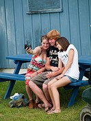Teens snap pictures at the Union County Fair in Union, Maine