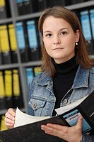 Tax assistant, young woman with files