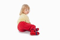 boy with long blond hair sitting on the floor_clipping path