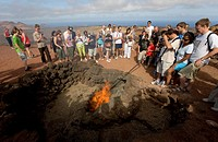Tourist attraction, a barbecue using embers of the hot lava ash, Montanas del Fuego Mountains of the Timanfaya National Park, Lanzarote, Canary Island...
