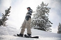 snowboarder on snowboard in the mountains of Austrian Alps, Tyrol, Tirol, Austria