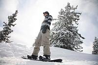 snowboarder on snowboard in the mountains of Austrian Alps, Tyrol, Tirol, Austria