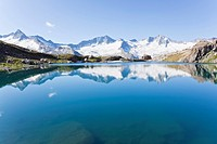 Mountain lake reflecting Zillertal Alps, Tyrol, Austria