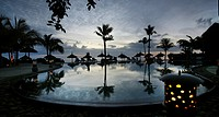 Pool, lantern, palm trees, sunshades, evening sky, reflection, Heritage deluxe hotel, Heritage Golf & Spa Resort, Bel Ombre, Republic of Mauritius, Af...