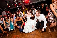 bride and groom dancing, wedding party