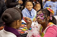 Detroit, Michigan - Face painting at the annual Adopt-a-Child Christmas Party for children from low-income families  The event was organized by a Detr...