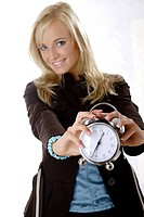 young woman with alarm_clock in her hands