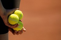 Close up of a ball boy holding tennis balls