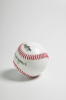 white baseball with red stitching