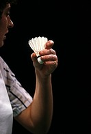 Close up of a badminton player holding a shuttlecock