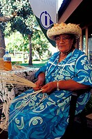 old woman braiding basket, French Polynesia