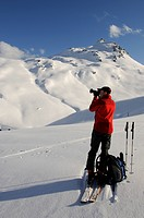 Ski hiker taking a picture during a tour up Mount Tristkopf, Kelchsau, Tyrol, Austria, Europe
