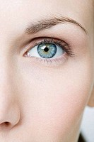 Blue eye of a young woman