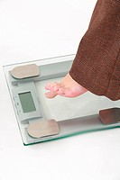 woman hasitating to use a scale