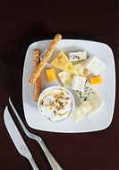 Plate of cheese with maple syrup dip