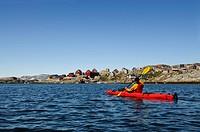 Kayaker near Tineteqilag, Ikasartivaq Fjord, East Greenland, Greenland