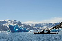 Icebergs and kayakers in the Stoklund_Fjord, East Greenland, Greenland